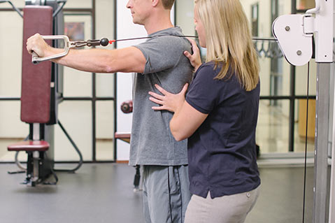 physical therapist working with client